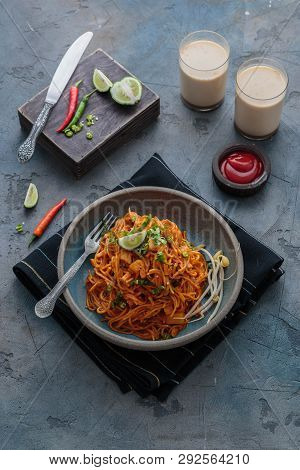 Spicy Asian Mee Goreng Mamak With Eggs, Ketchup And Chili, Top View
