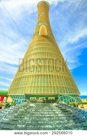 Doha, Qatar - February 21, 2019: Aspire Tower Or The Torch Doha, Skyscraper Hotel With Fountain In A