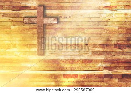 Wood Cross On Wooden Background In Church With Ray Of Light From Below