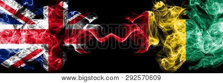 United Kingdom Vs Guinea, Guinean Smoky Mystic Flags Placed Side By Side. Thick Colored Silky Smoke