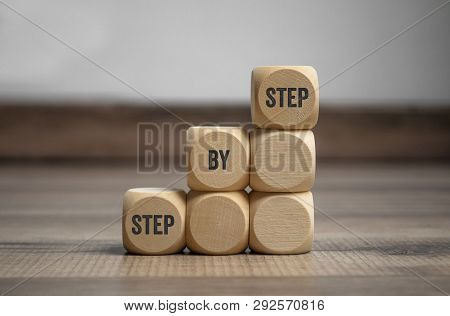 Cubes Dice With Step By Step On Wooden Background