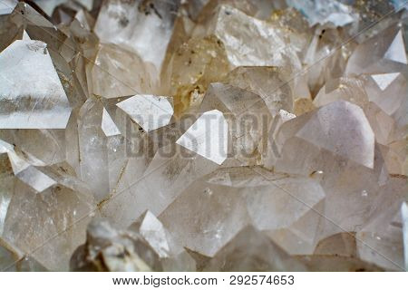 Huge crystal of colorless gemstone quarts, geology mineral background close up poster