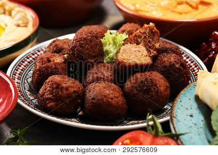 Middle Eastern Or Arabic Dishes And Assorted Meze, Concrete Rustic Background. Falafel. Turkish Dess