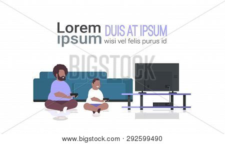 Fat Obese Father With Son Holding Joystick Game Pad Overweight African Family Plying Video Games On