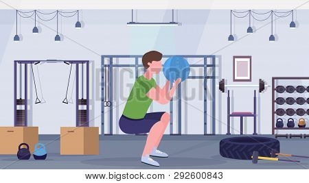 Sporty Man Doing Squats Exercises With Medicine Leather Ball Guy Training Cardio Workout Concept Mod