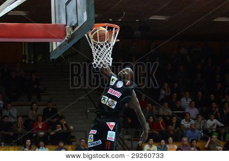 KAPOSVAR, HUNGARY - JANUARY 21: Unidentified player in action at a Hungarian National Championship basketball game with Kaposvar (white) vs. Szolnok (black) on January 21, 2012 in Kaposvar, Hungary.