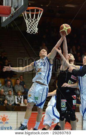 KAPOSVAR, HUNGARY - JANUARY 21: Nik Raivio (in white) in action at a Hungarian National Championship basketball game with Kaposvar (white) vs. Szolnok (black) on January 21, 2012 in Kaposvar, Hungary.