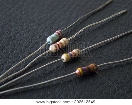 Detail Of Electronic Resistors In Black Background