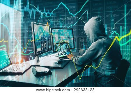 Side View Of Unrecognizable Hacker At Desktop Using Computers With Forex Chart On Blurry Office Back
