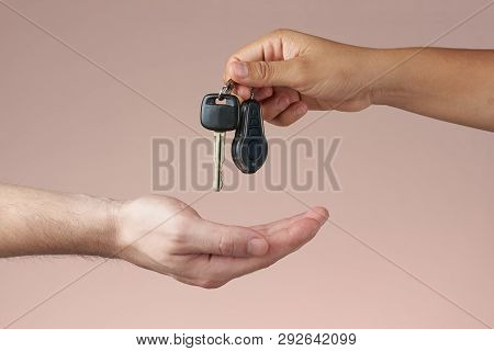Hand Receiving Car Keys. Receiving Or Giving Car Keys. Buying And Selling Concept. Renting Cars Conc