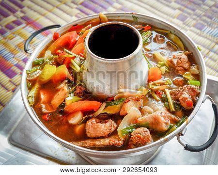 Spicy Chicken Soup Herbs And Spices In Hot Pot Served On Tray Asian Thai Food