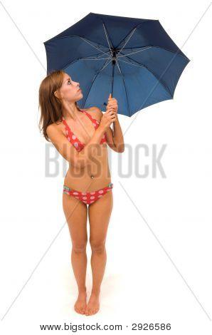 Woman With An Umbrella In A Bikini