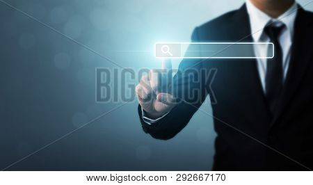 Searching Information Data On Internet Networking Concept. Hand Of Businessman Touching Magnifying G