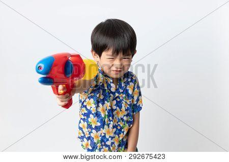 Welcome Thailand Songkran Festival, Portrait Of Asian Boy Wearing Flower Shirt Smiled With Water Gun