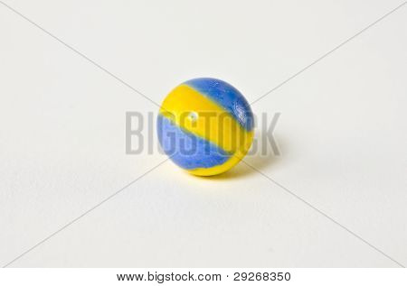Blue And Yellow Swirl glass Marble white background
