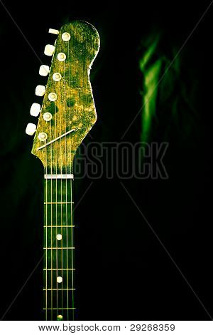 Neck And Strings Of Guitar with green hue