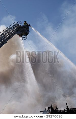 Firemen putting out a fire