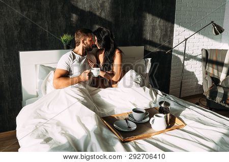Guy And Girl In Bed. Loving Couple In Bed. Breakfast In Bed. Tea In Bed. The Relationship Between A