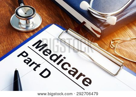 Medicare Part D Documents With Clipboard On A Desk.