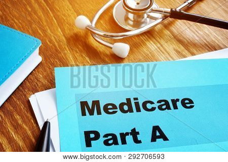 Medicare Part A Documents With Stethoscope On The Desk.