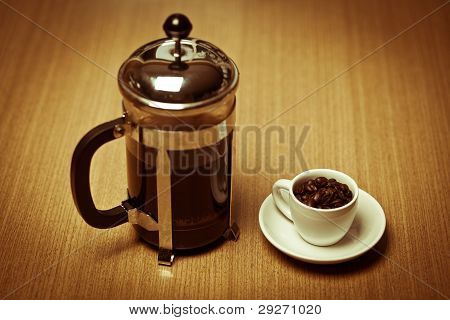 White Coffee Mug On White Plate W/ French Press