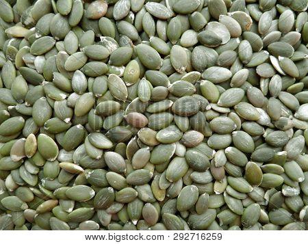 Background Texture Of Peeled Green Pumpkin Seeds