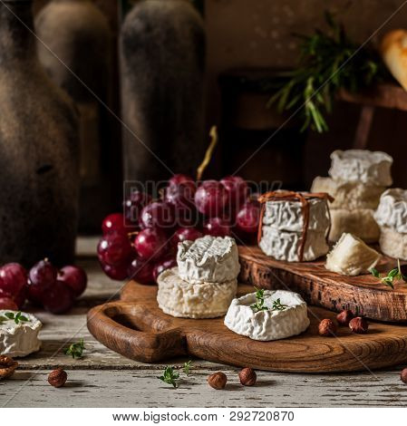 Variety Of French Cheeses And Another Provision In A Dusty Pantry, Square