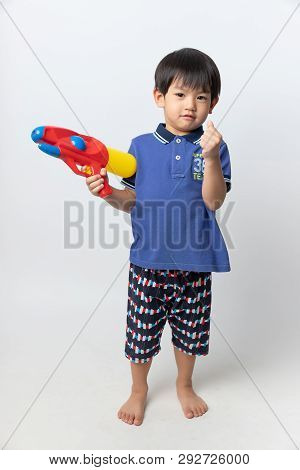 Welcome Thailand Songkran Festival, Portrait Of Asian Boy Smiled With Water Gun On White Background.