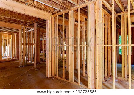 Close-up Of Beam Built Home Under Construction With Wooden Truss, Post And Beam Framework Frame Hous