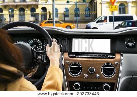 Woman Hand Holding Car Steering Wheel In Modern Car. Hands On Steering Wheel Of A Car Driving. Girl