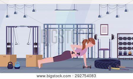 Sports Woman Doing Dumbbells Plank Exercise Girl Lifting Weight Working Out In Gym Crossfit Training
