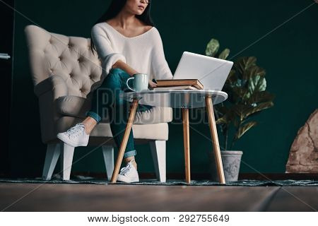 At Work. Close Up Of Young Woman Using Laptop While Working In Creative Space