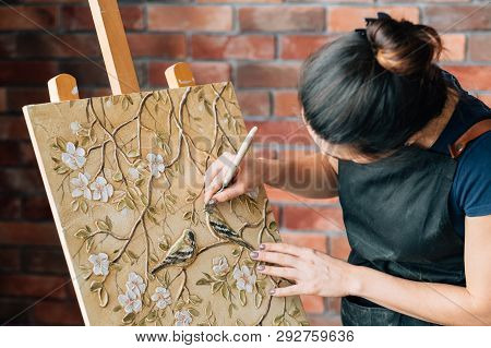 Artist At Work. Studio Workspace. Woman Painter With Palette Knife. Art Painting Canvas On Easel. Bi