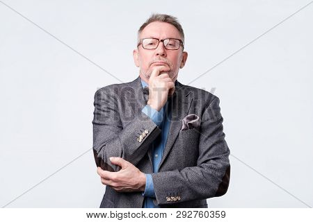 Senior Man In Suit And Glasses Doubt Expression