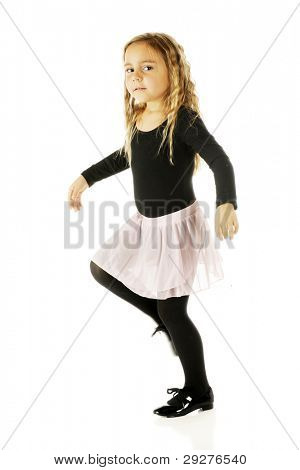 An attractive kindergartner tap dancing in her leotards,tutu and tap shoes.  Motion blur on her right shoe.  On a white background.