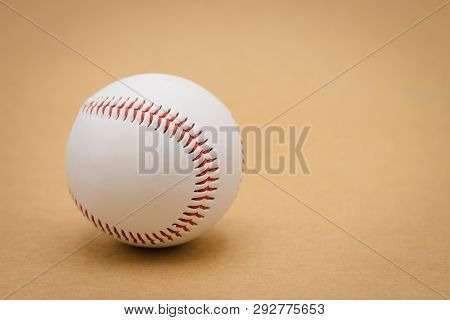 Isolated Baseball On A Brown Background And Red Stitching Baseball. White Baseball With Red Thread.b