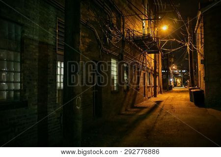 Vintage scary urban city alley at night in Chicago