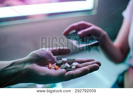 Buying Drugs. Drug Trafficking And Sale. Hand Of Drug Addict With Money Buying Drugs From Drug Deale