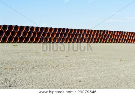 Stack of big plastic pipes ready at the construction site