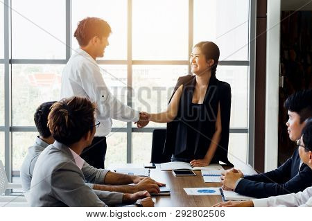 Group Of Business People In Corporate Meeting. Asian Smiling Happy Female Executive Shake Hands - Bu