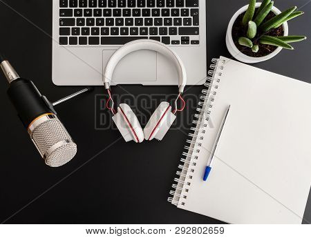 Podcast Recording Concept With Audio Recording Equipment On Dark Table