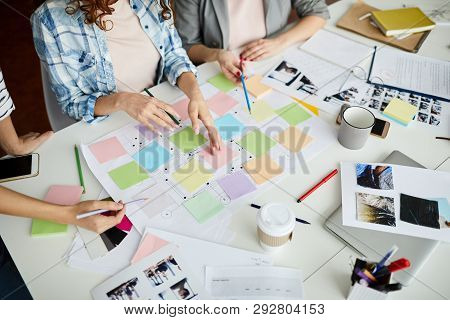 High Angle Closeup Of Contemporary Business Team Planning Project Placing Colorful Stickers On Roadm