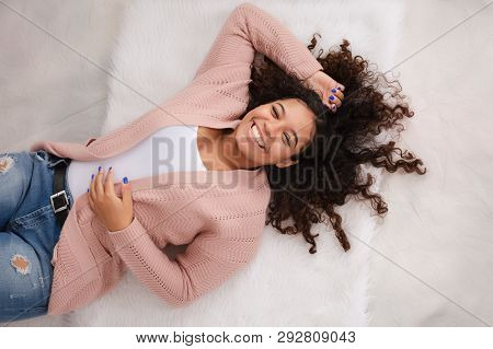 Beautiful, Laughing Biracial High School Senior With Curly Hair And Perfect Smile