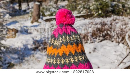 Pom-pom Hat With Winter Landscape In The Background