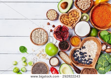 Healthy Food Background From Fruits, Vegetables, Cereal, Nuts And Superfood. Dietary And Balanced Ve