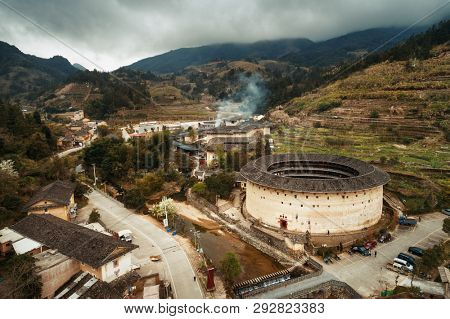 Aerial view of Tulou, the unique dwellings of Hakka in Fujian, China. poster