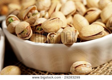 Pistachios In A White Saucer