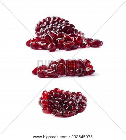 Pomegranate Seeds Isolated On White Background. Ripe Pomegranates Close-up. Sweet And Juicy Garnet W
