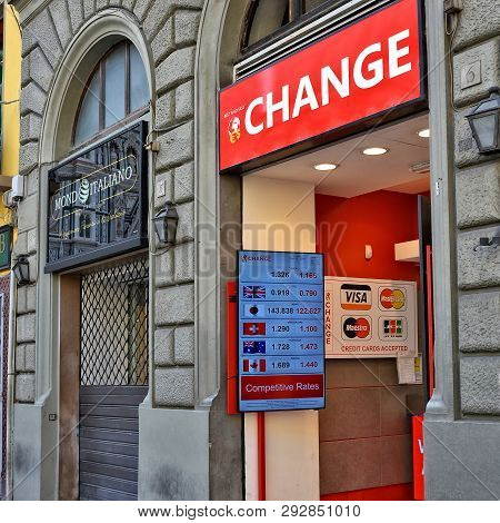 Currency Exchange. Banking Industry In West Europe. Red Sign And Currency Rate Table In An Exchange