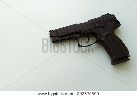 Pneumatic Pistol Isolated Over White Background. Handgun For Your Safety. Weapon Concept. Shooting G
